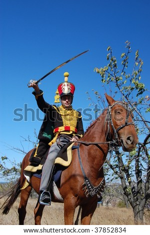 CRIMEA, UKRAINE  - SEPTEMBER 26 : Member of military history club wears Russian historical uniform during historical reenactment of Crimean War near Alma river September 26, 2009 in Crimea, Ukraine.