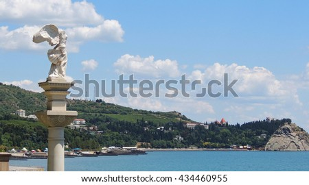 Crimean black sea coast city of Partenit, the sculpture of the Greek goddess Nike, women with wings and no head. - stock photo