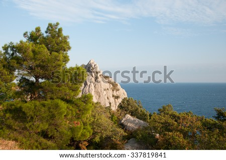 Crimean coastline with a view of Swan Wing rock at dusk