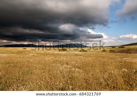 Crimean mountain landscape with beautiful cumulus clouds in the sky