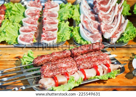 Crimean tatar cuisine - skewers of raw shish kebabs and lamb meat - stock photo