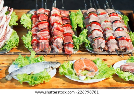 Crimean tatar cuisine - skewers of shishkebabs and raw fish for grill