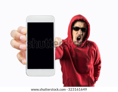 criminal hacker showing the smartphone which is pirated on white background - stock photo