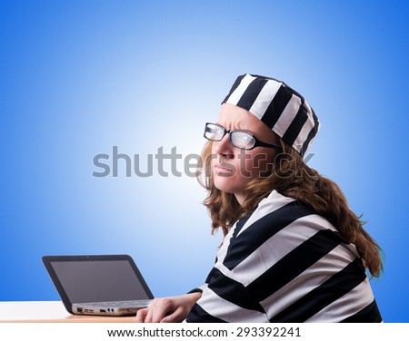 Criminal hacker with laptop against gradient  - stock photo