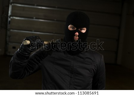 criminal holding a hammer - stock photo