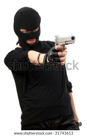 Criminal in black mask with gun isolated over white background. Focus to gun. - stock photo