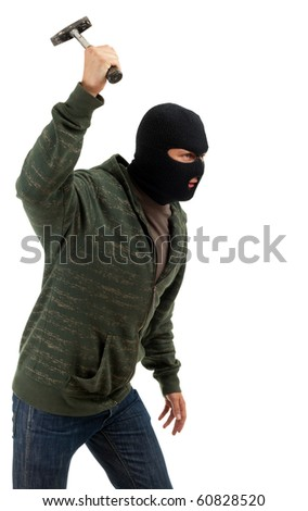 criminal in dark clothes and balaclava with hammer - stock photo