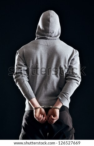 Criminal in handcuffs arrested for his crimes - stock photo