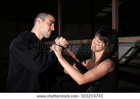 criminal kidnapping a girl with a knife - stock photo
