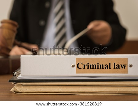 Criminal law document folder with lawyer work at law firm.
