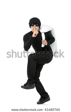 Criminal running away carrying a bag isolated against white background - stock photo