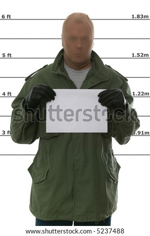 Criminal's mugshot, blank sign for your own text. - stock photo