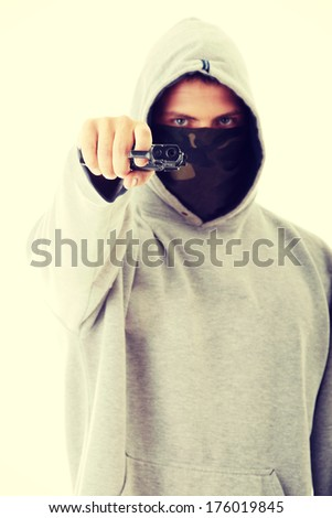 Criminal theme - masked man with gun - stock photo