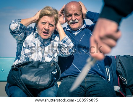 criminal try to rob money to an old couple  - stock photo