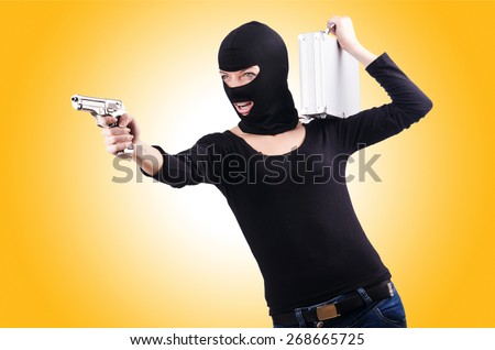 Criminal with gun isolated on white