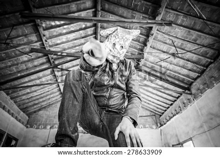 Criminal with knife in abandoned house, violence - stock photo