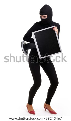 criminal woman in dark clothes and balaclava with screen of computer
