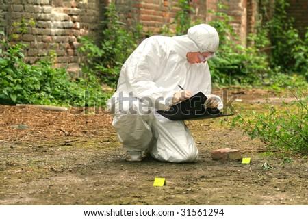 criminologist makes short notices - stock photo