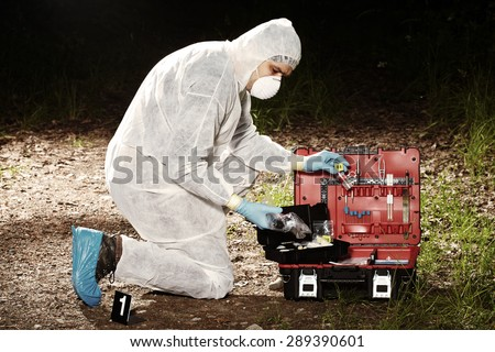Criminologist technician on place of crime - stock photo
