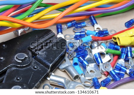 Crimping tool and cable terminals - stock photo
