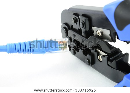 Crimping tool with connector jack  - stock photo