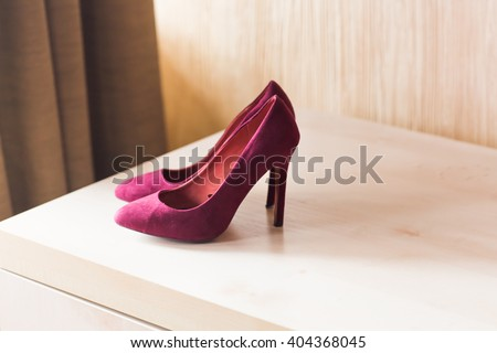 crimson shoes on high heels - stock photo