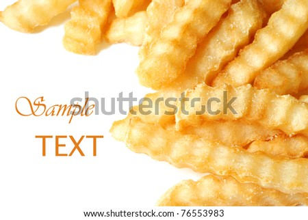 Crinkle cut french fries on white background with copy space.  Macro with shallow dof. - stock photo