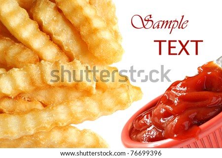 Crinkle cut french fries with ketchup on white background with copy space.  Montage of two macros blended together.  Shallow dof. - stock photo