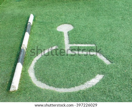 Cripple wheelchair sign and arrow sign on the road;cripple icon  - stock photo