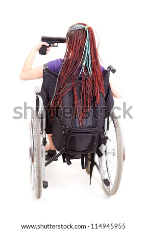 crippled girl on wheelchair pointing gun at her head, full length, white background - stock photo