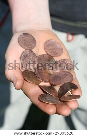 Crisis: devaluation of currency -  Coins squashed on railwaytrack by train - stock photo