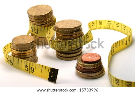 crisis: measuring tape and coins isolated on white - stock photo