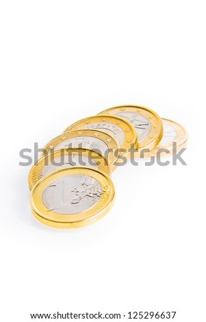crisis of eurozone, detail of some euro coins on white background