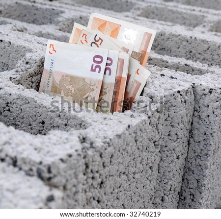 Crisis of the construction. Money in brick - stock photo