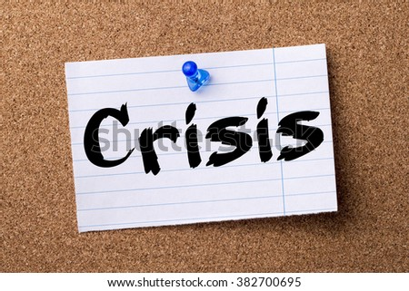 Crisis - teared note paper pinned on bulletin board - horizontal image - stock photo