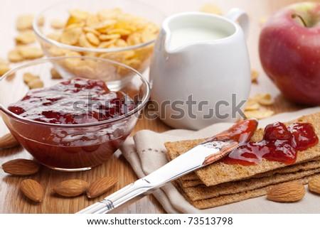 crisp bread with jam for breakfast - stock photo