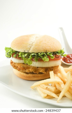 crisp chicken burger with tomato onion cheese lettuce isolated - stock photo