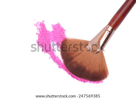Crisp eyeshadow makeup and brush on a white background - stock photo