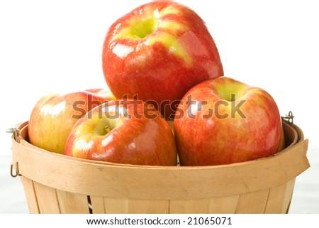 Crisp fall apples in a small wooden bushel. - stock photo