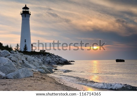 Crisp Point Lighthouse sunset, lake Superior Michigan - stock photo