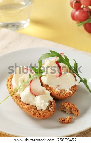 Crisp rolls with cheese spread  - stock photo