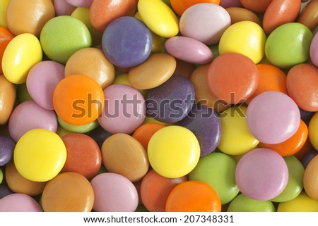 Crisp sugar shell coated chocolate beans or sweets - stock photo