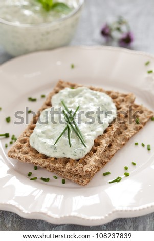 crispbread with chives and curd - stock photo