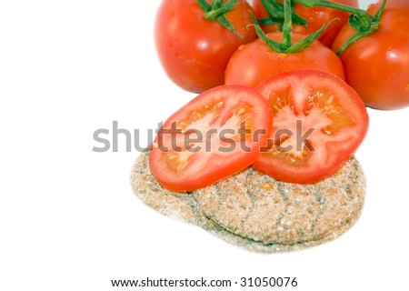 Crispbread with tomatoes, isolated on white - stock photo
