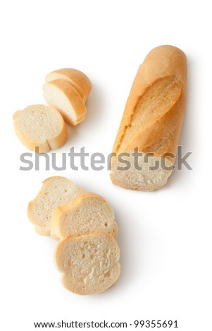 Crispy baguette and slices. Isolated on a white. - stock photo