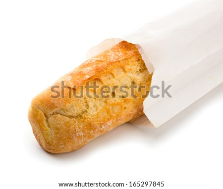 Crispy baguette packed in white paper. Isolated over white. - stock photo