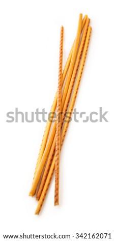 Crispy bread straw in closeup on white background - stock photo