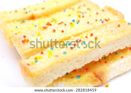 Crispy bread with sugar - stock photo
