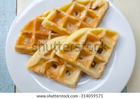 Crispy butter cashew nut Waffles on white ceramic dish and wood table