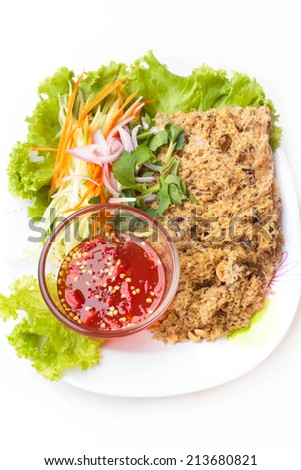crispy catfish spicy salad with mango and sweet sauce, Thai food.